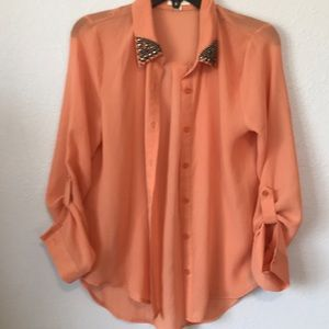 Shear orange blouse with studded collar